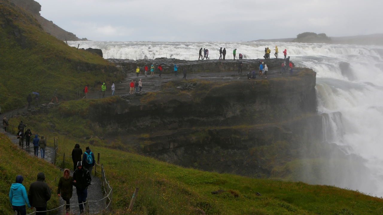 Iceland | Cost per litre - Rs 134.83 | People seen walking along a tourist spot. (Image: Reuters)