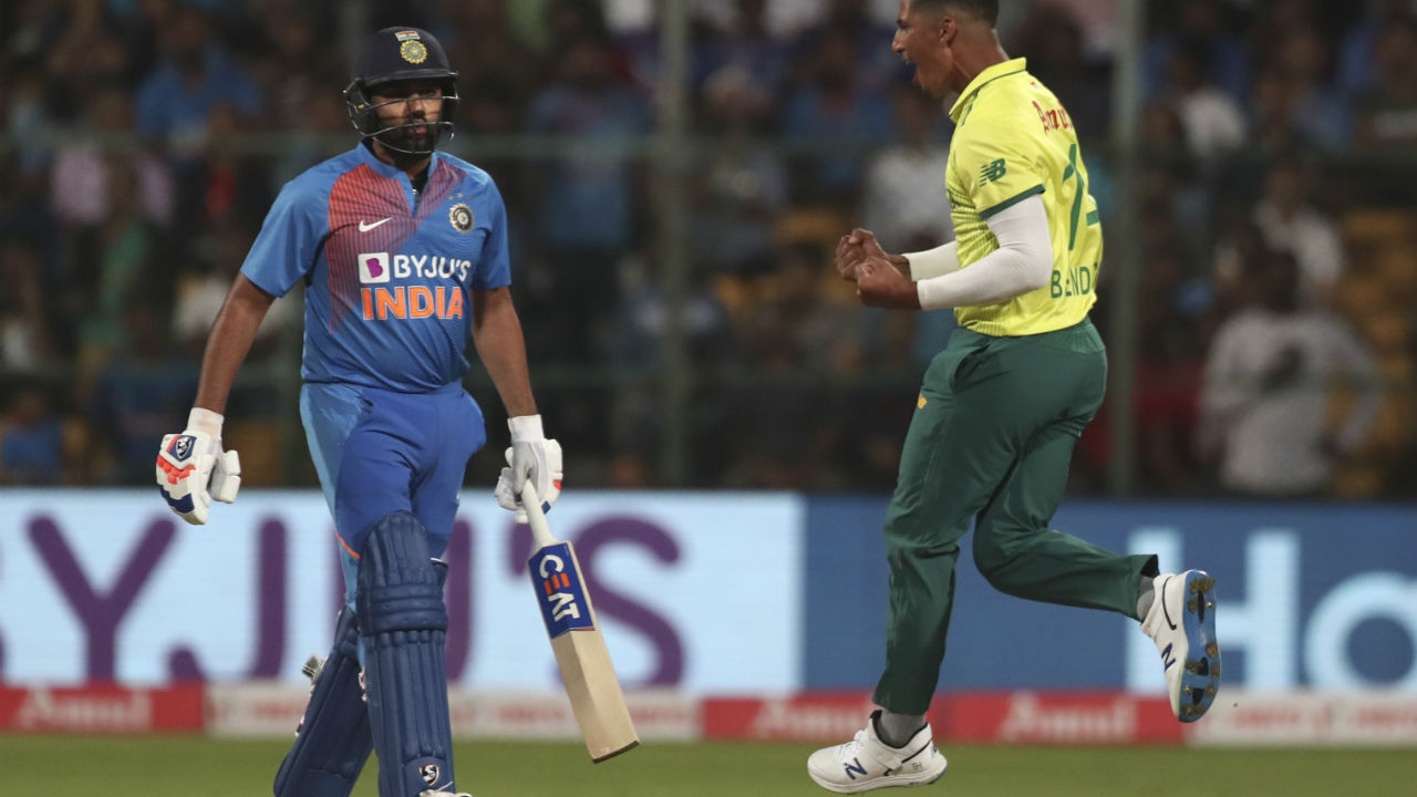 Beuran Hendricks gave Proteas the first breakthrough as he forced an edge off Rohit Sharma's bat on the first delivery of the third over. Reeza Hendricks took an easy catch at first slip. Rohit made 9 off 8 as India were 22/1. (Image: AP)