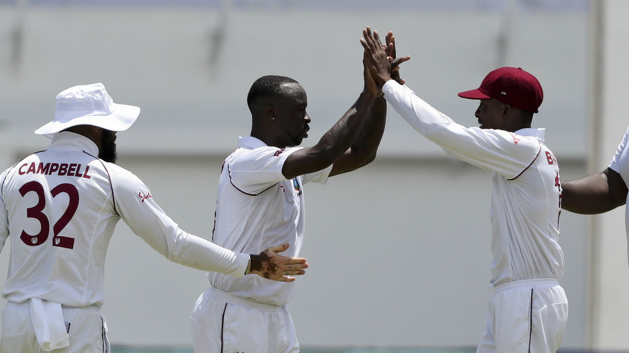 Roch struck twice in the 21st over of India's second innings. The Windies pacer got Rahul and Kohli caught behind by Hamilton off successive deliveries. Rahul made 6 off 63 deliveries while Kohli was out on a 'golden-duck'. India were 36/3 with a lead of 335 runs when Kohli departed. (Image: AP)