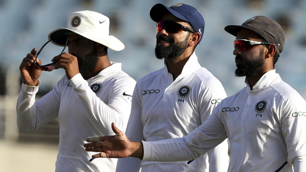 India wrapped the match and won the series 2-0 when Jadeja clean-bowled Jason Holder on fifth delivery of the 59th over. West Indies were all-out on 210, thus handing India a win by 257 runs. The win was 28th Test victory for Virat Kohli as captain and he's gone past MSD to become the most successful in this format for India. (Image: AP)