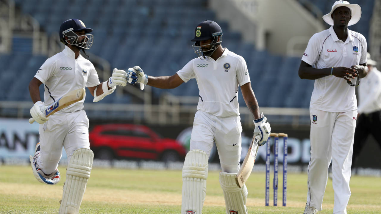 The fifth-wicket partnership for India added a total of 108 runs from 144 balls before Kohli declared India's innings at 168/4 with a lead of 467 runs. Vihari remained unbeaten on 53 while Rahane was on 64. (Image: AP)