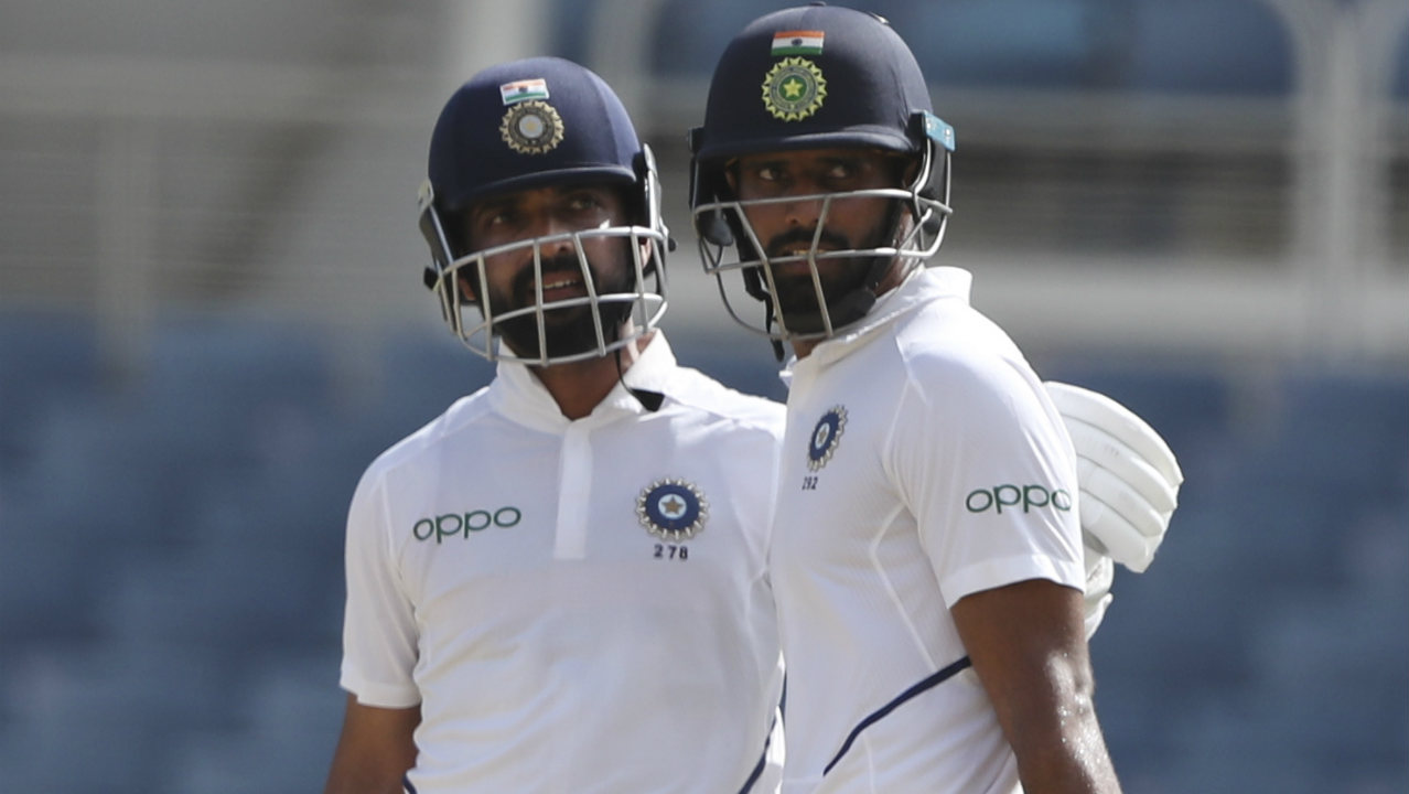 The Rahane-Vihari duo picked up the pace after Tea and continued to frustrate the West Indies attack. Vihari was the first of the two batsmen to bring up his fifty in the 50th over. Rahane followed completing his half-century with a boundary in the next over. (Image: AP)