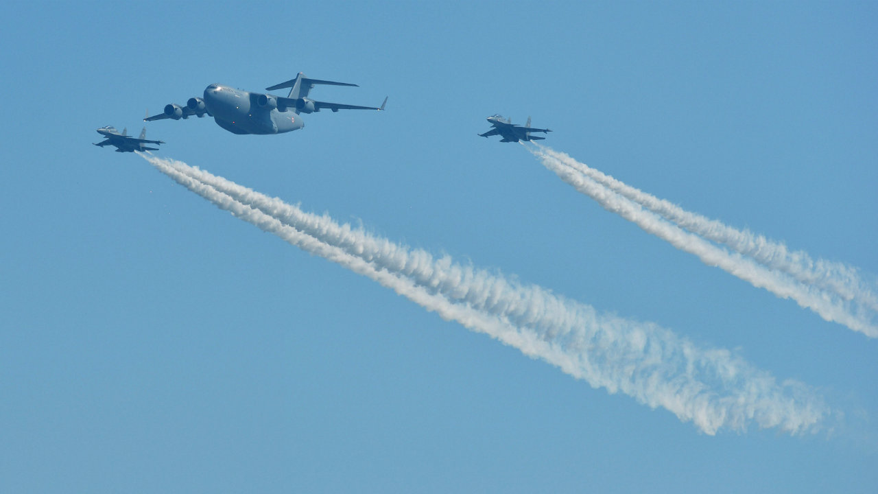 A C-17 Globemaster III and two Sukhoi Su-30MKI aircraft flypast in a formation. (Image: PTI)