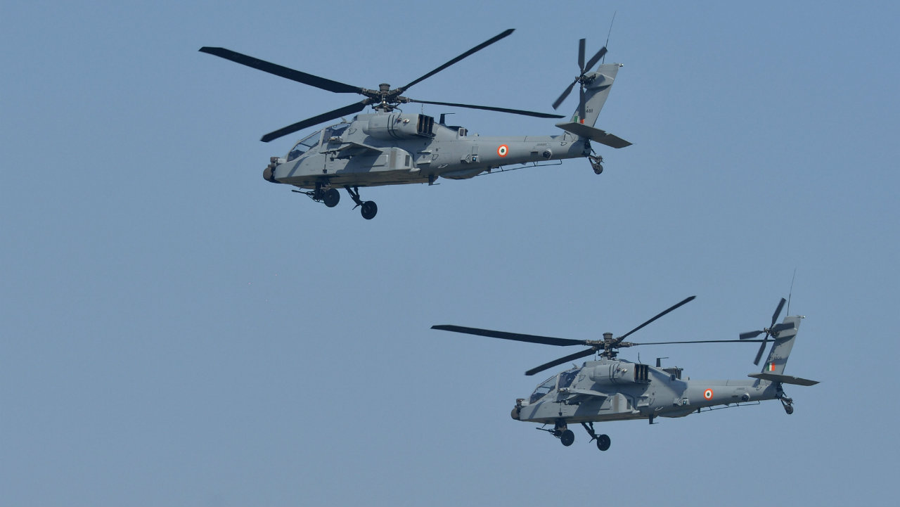 Newly-inducted IAF Apache helicopters perform during the Indian Air Force Day celebrations. (Image: PTI)