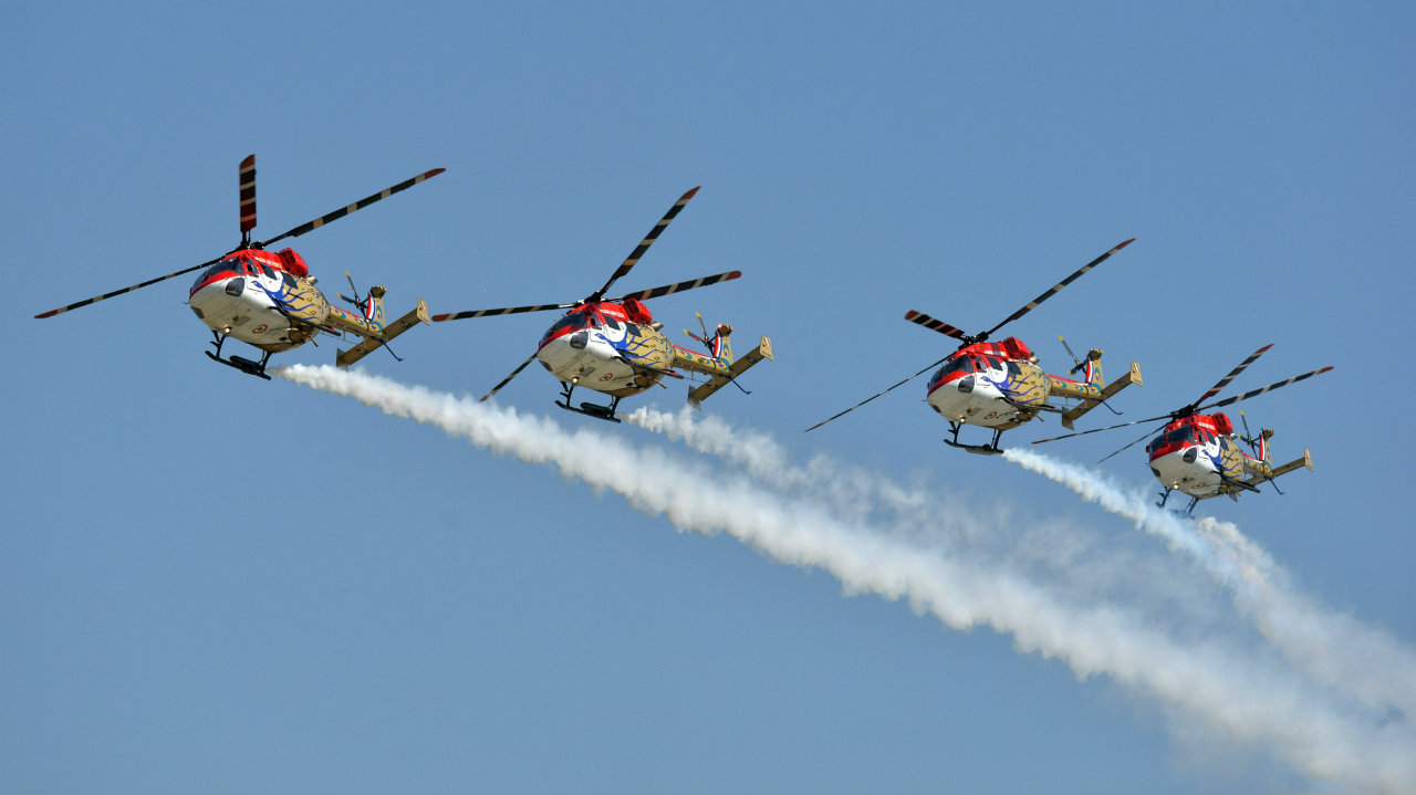 IAF's Sarang helicopters perform during the air show to mark the 87th Indian Air Force Day. (Image: PTI)