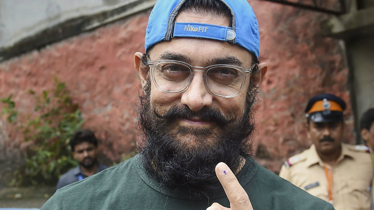 In Pics | Bollywood celebrities Aamir Khan, Madhuri Dixit among early voters