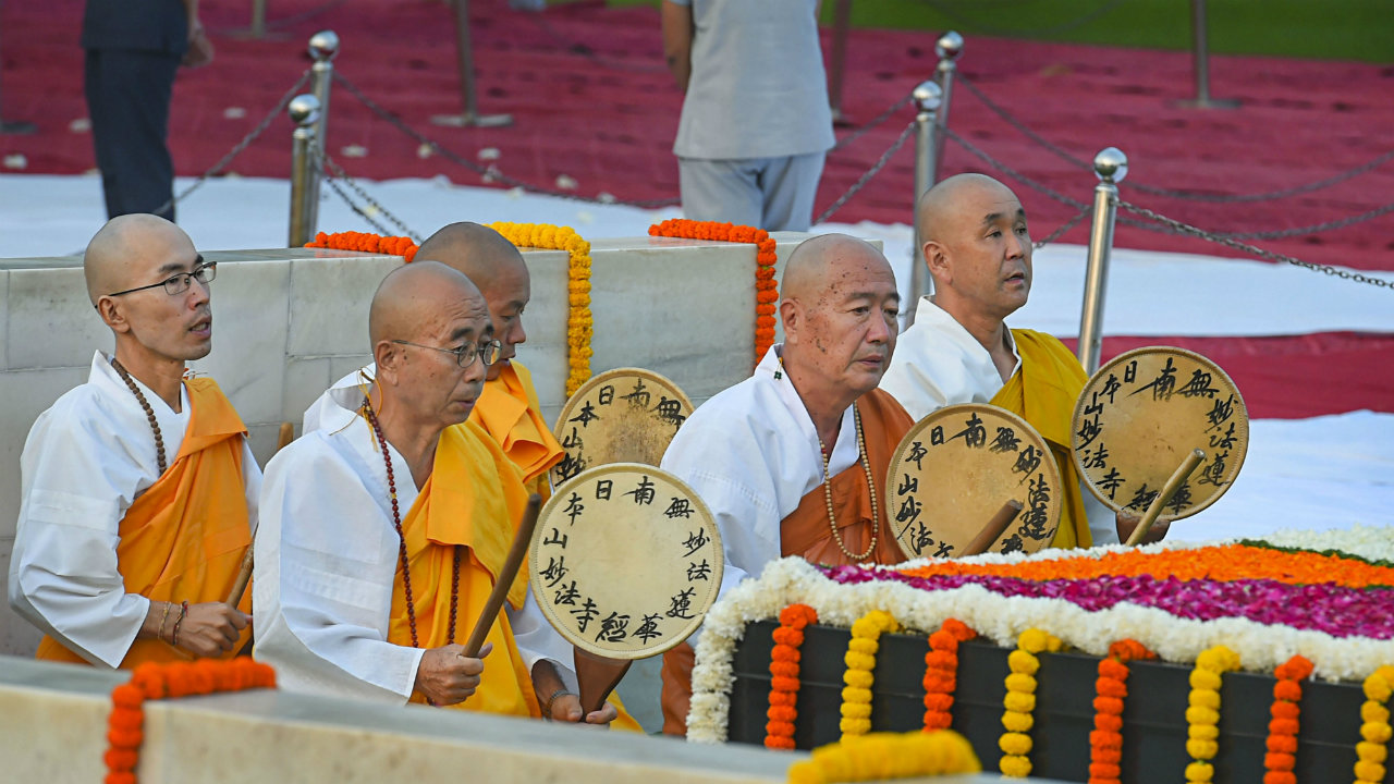 Buddhist monks pay homage to Mahatma Gandhi on the occasion of his 150th birth anniversary at Rajghat, in New Delhi (Image: PTI)