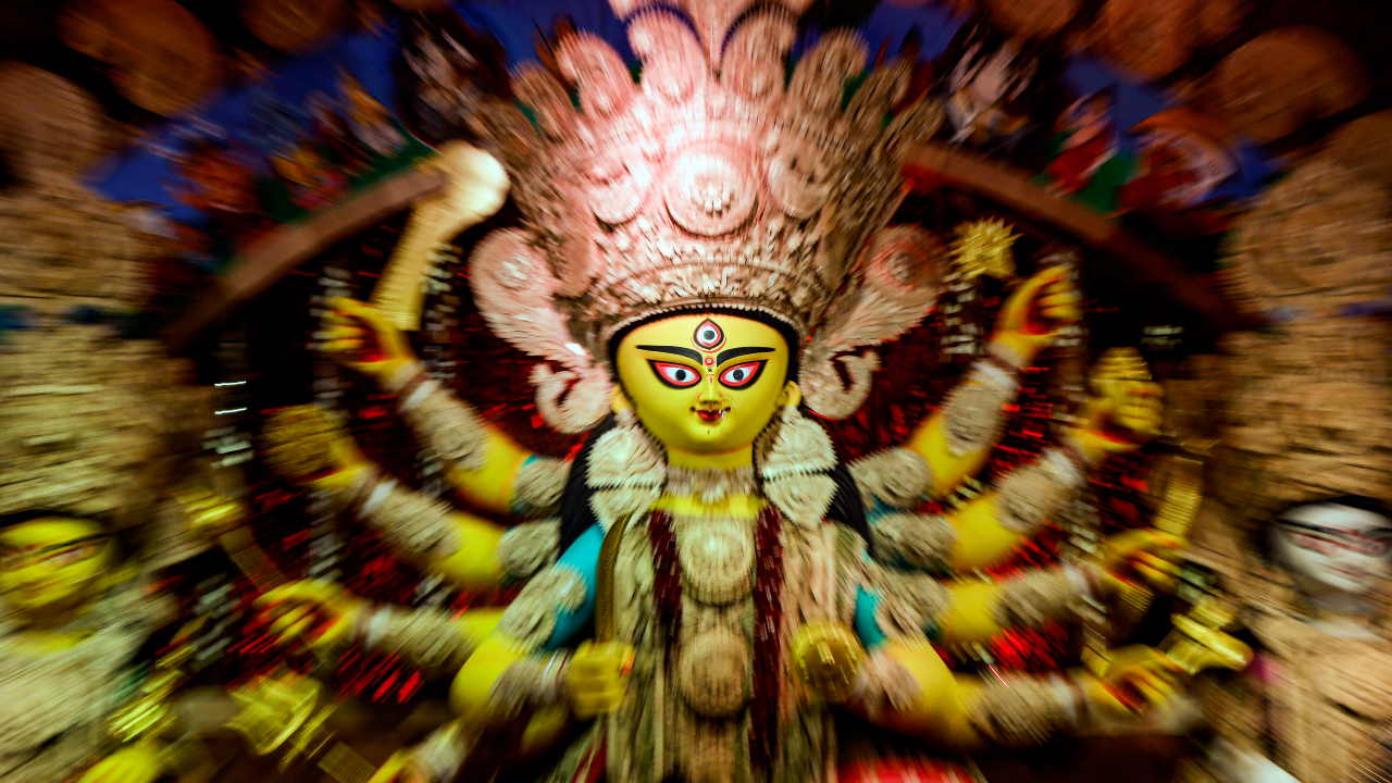 """A traditional clay image of Hindu goddess Durga inside a """"pandal,"""" or a temporary structure set up to worship during the Durga Puja festival in Kolkata. The five-day festival commemorates the slaying of a demon king by goddess Durga, marking the triumph of good over evil. (Image: AP)"""