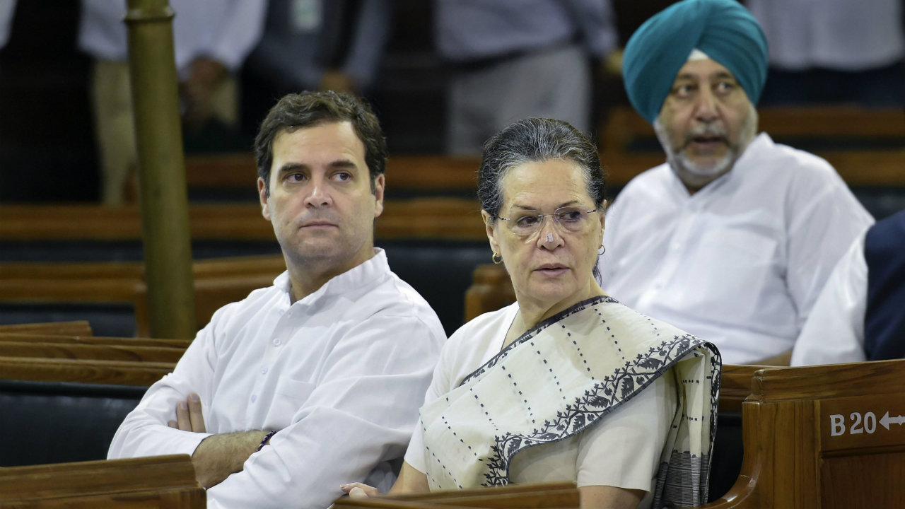 Congress President Sonia Gandhi and party leader Rahul Gandhi during a tribute-paying ceremony on the 150th birth anniversary of Mahatma Gandhi at Parliament House, in New Delhi (Image: PTI)