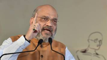 Maharashtra Assembly Election   Amit Shah dares Rahul Gandhi to declare Congress will restore Article 370 in J&K