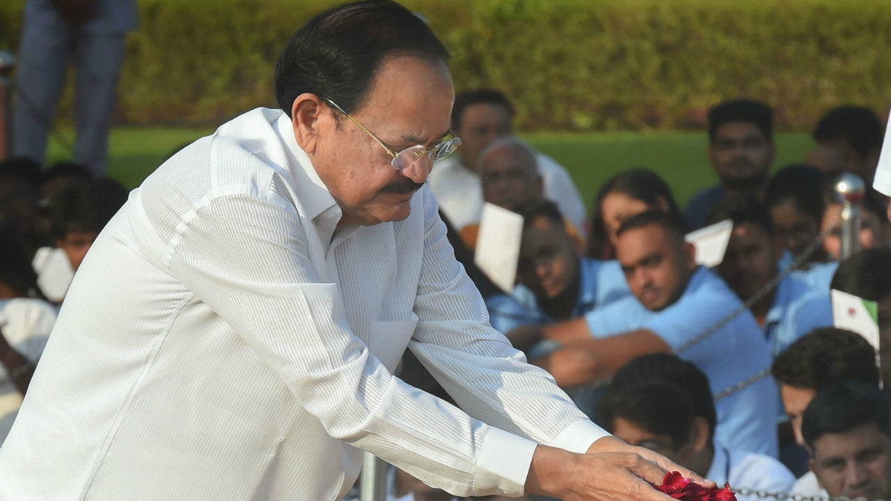 Vice-President Venkaiah Naidu pays homage to Mahatma Gandhi on the occasion of his 150th birth anniversary at Rajghat, in New Delhi (Image: PTI)