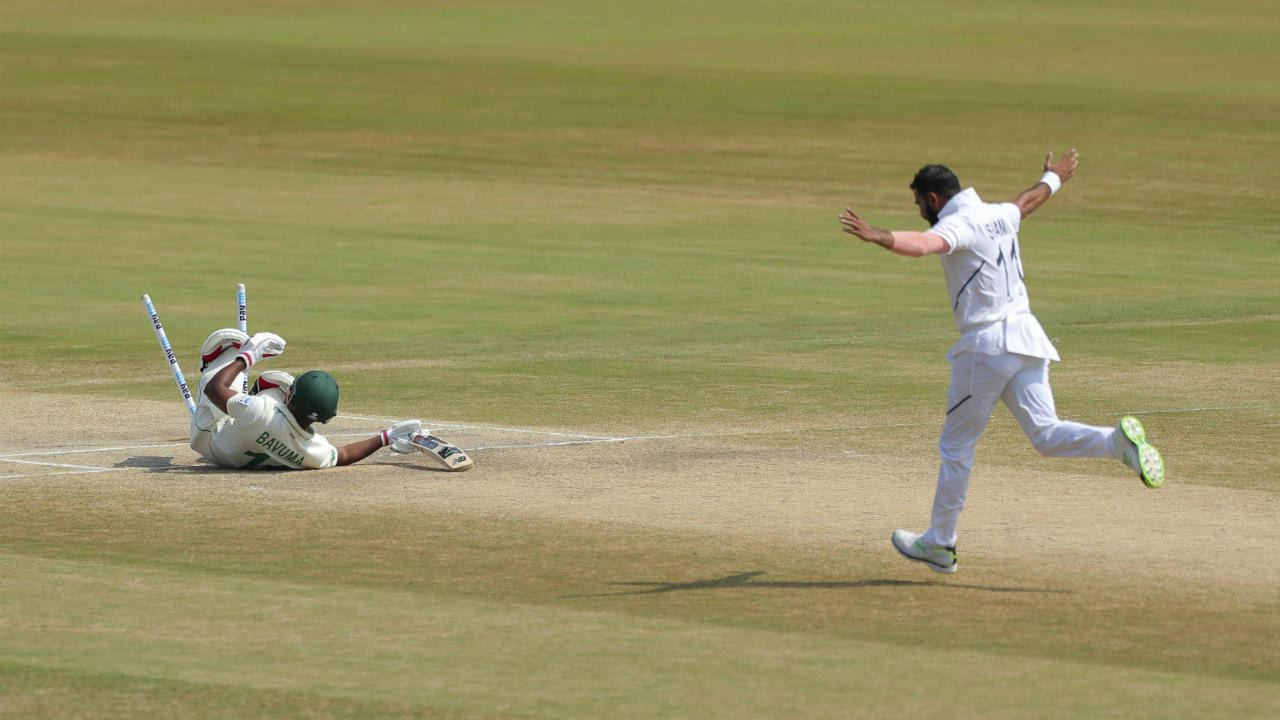 Mohammed Shami who went wicket-less in the first innings struck in the very next over sending back Temba Bavuma on a duck. Shami got a length delivery to stay low and crash into the stumps picking up his 1st wicket of the match. (Image: AP)