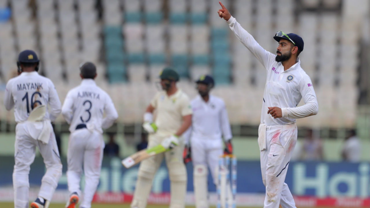 The Indian captain Virat Kohli tried various methods to get the breakthrough including handing the ball to Rohit Sharma to bowl a few overs but it didn't bear fruit as both de Kock and Elgar powered through with confidence. (Image: AP)