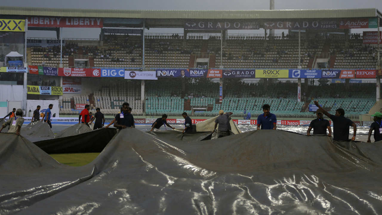 Soon it started raining and the groundsmen were forced to bring on covers. The rains delayed the start of the third session. (Image: AP)