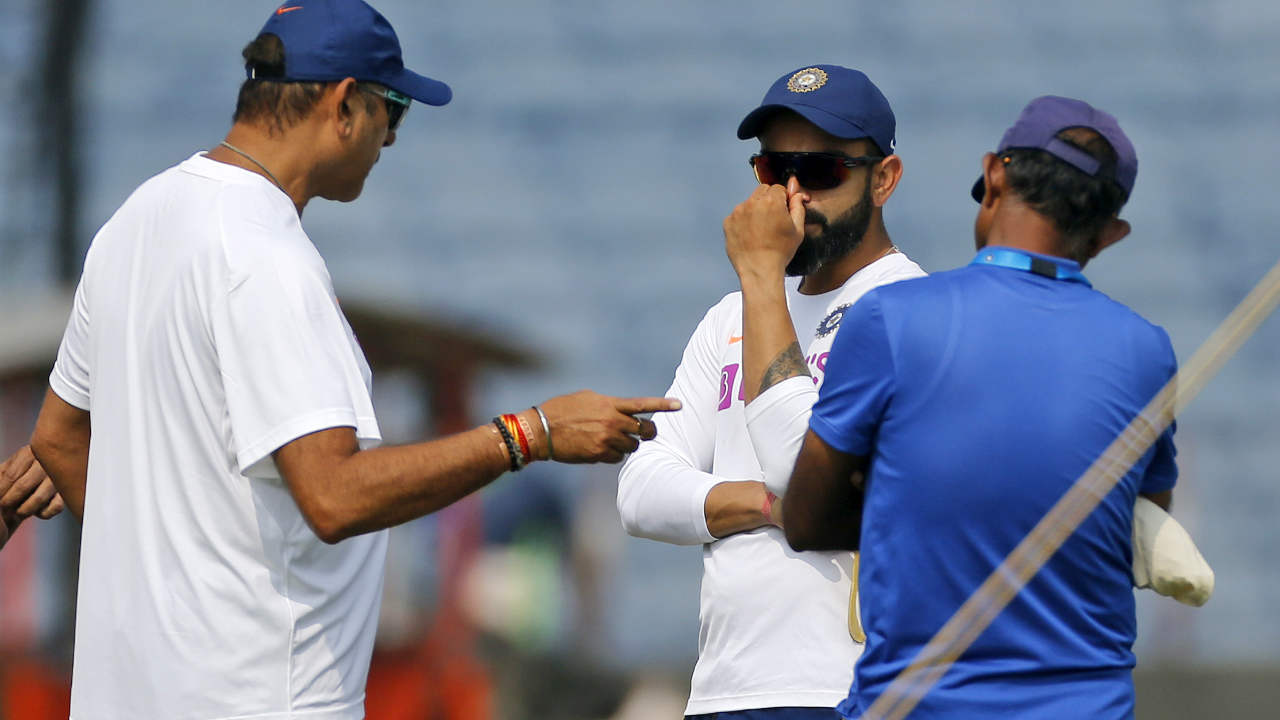 India and South Africa locked horns in the second Test of the three-match Test series at MCA stadium in Pune. For the second time in the series Indian skipper Virat Kohli won the toss and oped to bat first. Both teams opted for extra pacer in the playing XI. India dropped Hanuma Vihrai to include Umesh Yadav while South Africa chose Anrich Nortje over Dane Piedt. (Image: AP)