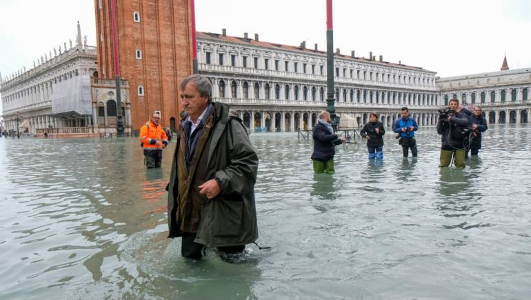 Venice's Mayor, Luigi Brugnaro, walks on St Mark's Square on November 13, 2019 (Image: Reuters)
