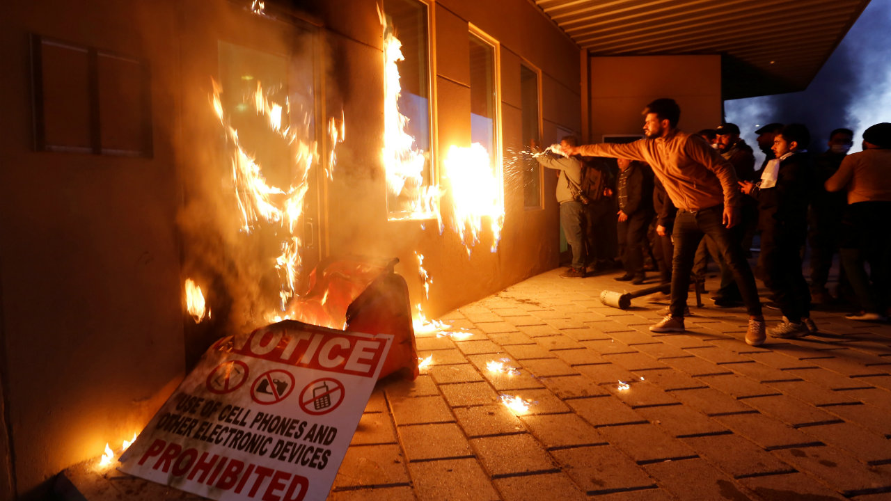 Protesters and militia fighters set fire to a reception room of the U.S. Embassy. (Image: Reuters)
